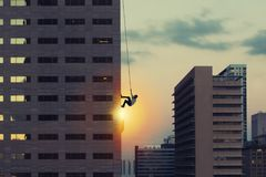 Businessman climb a skyscraper. Achievement business goal and difficult career concept Stock Photography