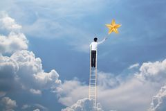 Businessman climb up on ladder to reach star, successful and win concept. Businessman climb up on ladder to reach star successful and win concept royalty free stock photo