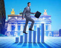 The businessman climbing bar charts in business concept Royalty Free Stock Photo