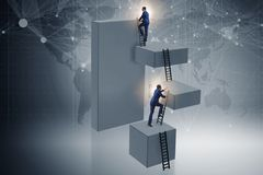 The businessman climbing blocks in career ladder business concept Royalty Free Stock Image