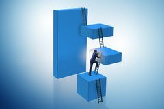The businessman climbing blocks in challenge business concept. Businessman climbing blocks in challenge business concept Royalty Free Stock Photography