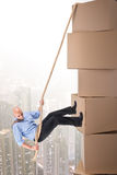 Businessman climbing boxes Stock Photo