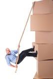 Businessman climbing boxes Royalty Free Stock Photos