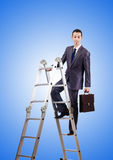 Businessman climbing career ladder against Royalty Free Stock Photos