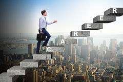 The businessman climbing career ladder in business concept. Businessman climbing career ladder in business concept Stock Image