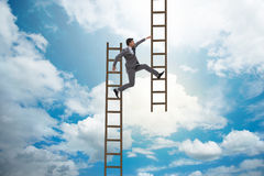 The businessman climbing career ladder in business concept Royalty Free Stock Photography