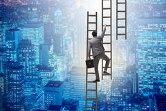 The businessman climbing career ladder in business concept Stock Image