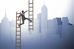 The businessman climbing career ladder in business concept Stock Images
