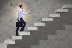 The businessman climbing career ladder in business concept. Businessman climbing career ladder in business concept Royalty Free Stock Photo