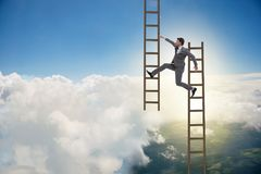 The businessman climbing career ladder in business concept Royalty Free Stock Images