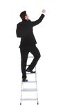 Businessman climbing career ladder Stock Image