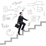 Businessman climbing the career stairs. Royalty Free Stock Photos