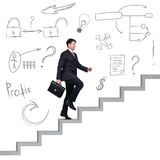 Businessman climbing the career stairs. Stock Photography