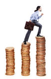 Businessman climbing  coins stacks Royalty Free Stock Photo
