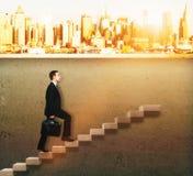 Businessman climbing concrete ladder Stock Photos