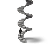 Businessman climbing concrete spiral staircase Royalty Free Stock Image