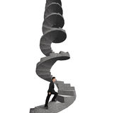 Businessman climbing concrete spiral staircase Stock Images