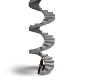 Businessman climbing concrete spiral staircase Royalty Free Stock Photo