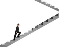 Businessman climbing on concrete stairs Royalty Free Stock Images