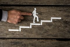 Businessman climbing the corporate ladder Royalty Free Stock Photography