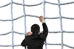 Businessman climbing crisscross rope net isolated on white Royalty Free Stock Image