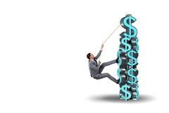 The businessman climbing dollar challenge tower Royalty Free Stock Photos