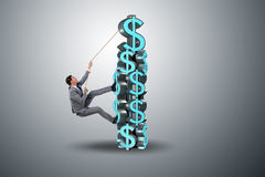 The businessman climbing dollar challenge tower Royalty Free Stock Photo