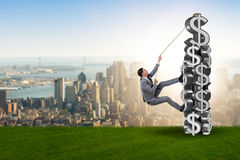 The businessman climbing dollar challenge tower Stock Photo