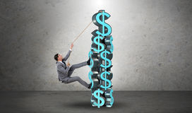 The businessman climbing dollar challenge tower Stock Image