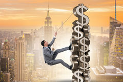 The businessman climbing dollar challenge tower Stock Photography