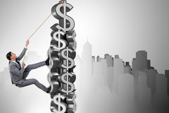 The businessman climbing dollar challenge tower. Businessman climbing dollar challenge tower Stock Photography