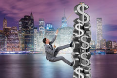 The businessman climbing dollar challenge tower. Businessman climbing dollar challenge tower Royalty Free Stock Photos