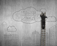 Businessman climbing and drawing cloud app icons doodles Stock Photography
