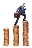 Businessman climbing gold coins Royalty Free Stock Photography