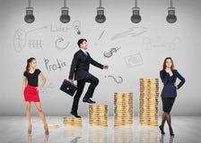 Businessman climbing gold coins stacks Stock Photo