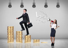 Businessman climbing gold coins stacks Royalty Free Stock Images