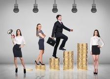 Businessman climbing gold coins stacks Stock Photos