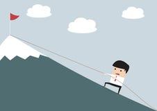 Businessman Climbing Hill Stock Image