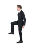 Businessman climbing imaginary steps Stock Image
