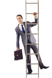 Businessman climbing the ladder Stock Photos