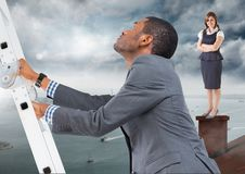 Businessman climbing ladder and Businesswoman standing on Roof with chimney and cloudy city port Royalty Free Stock Image
