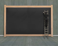 Businessman climbing ladder drawing on blank black board Stock Images