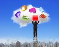 Businessman climbing ladder getting blank red icon from cloud. Royalty Free Stock Photos