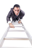 Businessman climbing the ladder Royalty Free Stock Images