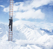 Businessman climbing royalty free stock photography