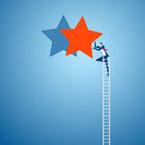 Businessman climbing ladder reaching to the star and success. Competition and business concept. Royalty Free Stock Image