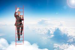 Businessman climbing ladder in sky Stock Photos