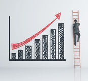 Businessman climbing on ladder Stock Images
