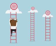 Businessman climbing the ladder Stock Images