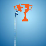 Businessman climbing ladder to combine trophy puzzle pieces. Make a success concept Stock Images